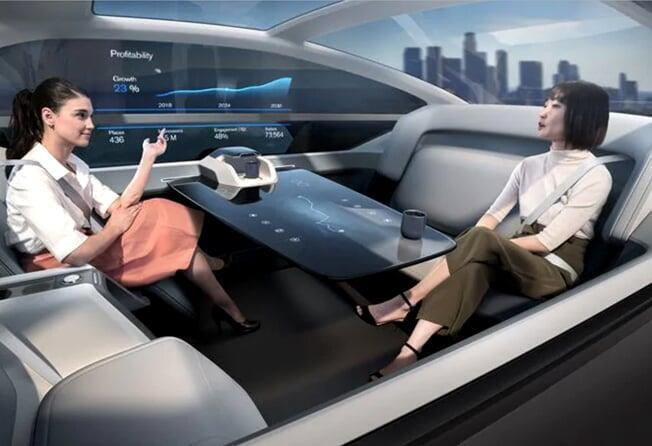 two women chatting in a driverless car
