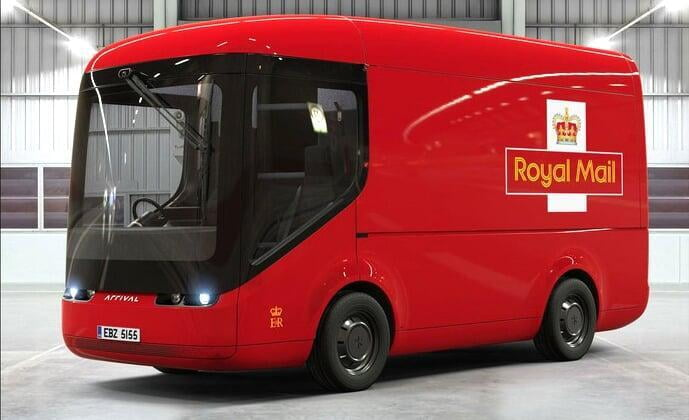 A bright red Royal Mail delivery van in a grey warehouse