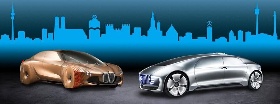 Two futuristic cars, one gold and one silver, in front of a graphic of a city skyline