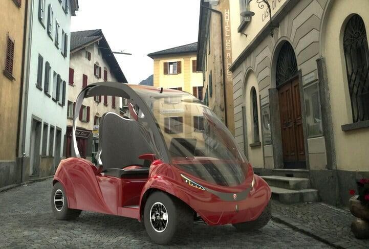 A red golf car in a medieval Italian town