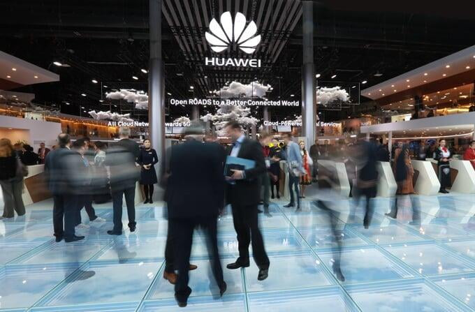 Men in dark suits on Huawei's stand at Mobile World Congress