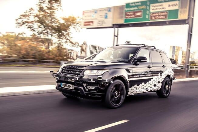 A black Self driving land rover speeding along the Coventry Ring Road in the UK